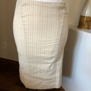 Bebe size 4 cream and tan striped skirt.